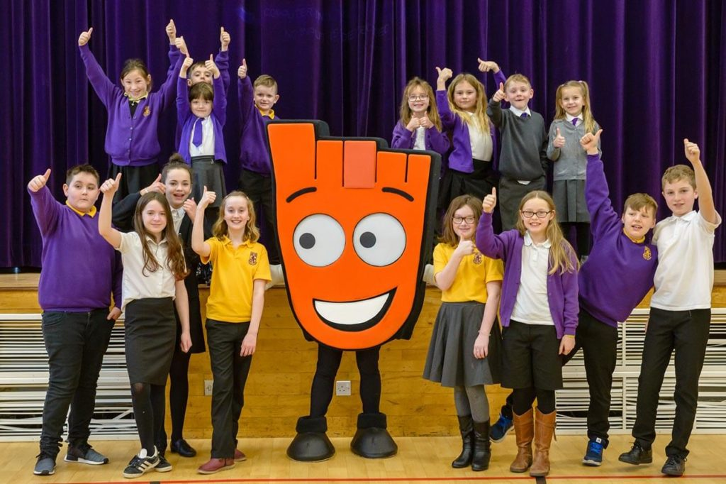 School children with the WOW mascot
